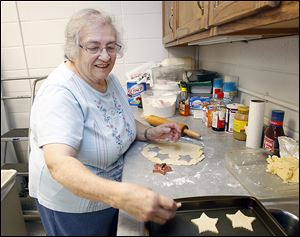 Sister Gretchen Faerber makes sugar cookies in Regina Hall in the Sylvania Franciscan Village.  The coordinator of the 18th annual Christmas bake and craft sale that bears her name has been busy preparing for the event, which will be held on Friday and Saturday.