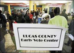Voters move through the line at the Early Vote Center at Summit Plaza last week. Early voting ends today.
