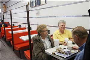 Becky Hackworth, left, Donetia Hurt, center, and Douglas Hurt, right, all of Lima, chat at the Kewpee hamburger restaurant. The three voted for President Obama in 2008, but since have turned their support to Mitt Romney.