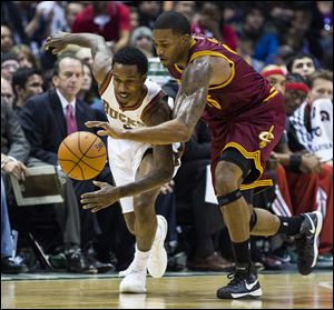 Cleveland Cavaliers' Alonzo Gee makes a steal from Milwaukee Bucks Brandon Jennings Saturday night.