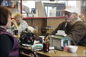 Deborah Core of Lima, left, and Lester Wood, eat a late breakfast at the Lickity Split in Lima. Mr. Wood says he might be one of the few undecided voters left in Ohio. He says the availability of jobs is what concerns him most.