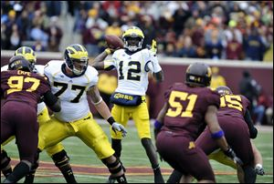 Michigan's Devin Gardner during an NCAA college football game against Minnesota, Saturday, Nov. 3, 2012, in Minneapolis. (AP Photo/Tom Olmscheid)