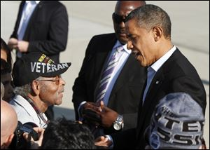 President Barack Obama talks today with World War II veteran Harkless Hutchings, 95, at  Rickenbacker International Airport in Columbus as he arrives for a campaign stop in Columbus.