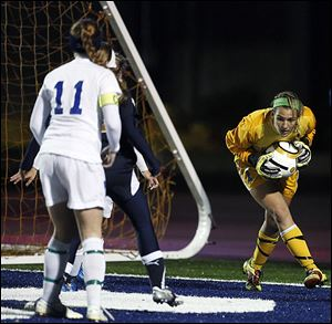 Slug: SPT regionalsoccer01p  THE BLADE/JEREMY WADSWORTH  Caption: St. Ursula goalie Sydney Yeager (1) makes a stop against Akron Archbishop Hoban during a Division II girls regional soccer semifinal Wednesday, 10/31/12, at Cedar Point Stadium in Sandusky, Ohio. St. Ursula won 1-0.