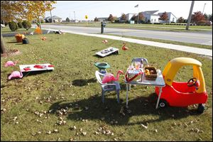 Flamingos hold a tailgate party in the front lawn of John & Bonnie Tursich's Perrysburg Township home.