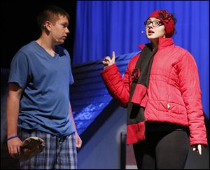 Trent Morelock and Haley Peterson perform during a dress rehearsal for Rossford High School's production of