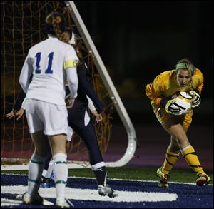 St. Ursula goalie Sydney Yeager (1) makes a stop against Akron Archbishop Hoban during a Division II girls regional soccer semifinal, 10/31/12, at Cedar Point Stadium in Sandusky. St. Ursula won 1-0.