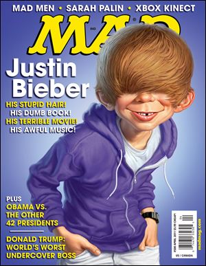 In this magazine cover image released by DC Comics, Alfred E. Neuman , the fictional cover boy of