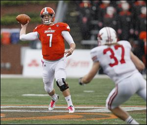 Bowling Green quarterback Matt Schilz fires a pass as Miami linebacker Pat Hinkel, 37, moves in during the third quarter of their  football game at Doyt Perry Stadium in Bowling Green, Saturday, October 13, 2012.