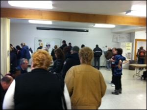 Voters stand in line at the Augsburg Lutheran Church in West Toledo in Library Village.