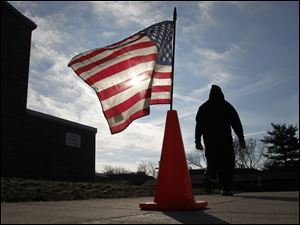 A voter leaves McCord Junior High School in Sylvania after casting their ballot.