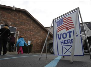 Voters head in to cast their ballot at Lambertville United Methodist Church.