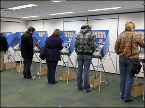 A line of Perrysburg residents cast their vote for president at the Way Public Library.
