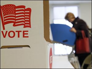 A voter casts her ballot at  Fort Meigs Elementary School in Perrysburg.