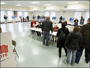 Voters check in at Fort Meigs Elementary School in Perrysburg.