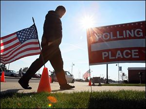 A voter heads into the polling place at Springfield High School in Holland on election day.