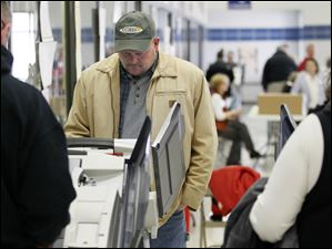 Congressional candidate Samuel 'Joe the Plumber' Wurzelbacher votes at Springfield High School in Holland.