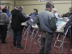 Voters at the Locke Branch of the Toledo-Lucas County Public Library in Toledo cast their ballots for national, state, and local officials.