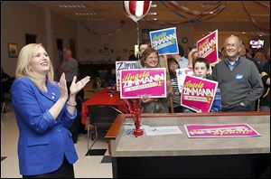 Angela Zimmann and supporters watch election results in Rossford. Ms. Zimmann lost to incumbent U.S. Rep. Bob Latta (R., Bowling Green).