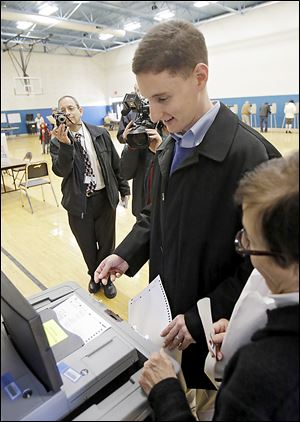 Republican senate candidate Ohio treasurer Josh Mandel slides his ballot into a scanner after voteing in Beachwood, Ohio Tuesday, Nov. 6, 2012. Mandel is challenging incumbent Democrat Sen. Sherrod Brown. (AP Photo/Mark Duncan)