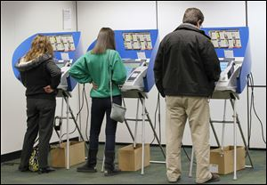 Voters cast their ballots at the Way Library in Perrysburg.