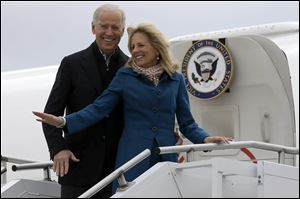Vice President Joe Biden, accompanied by his wife Jill Biden, board Air Force Two at a Delaware Air National Guard Base in New Castle , Del.