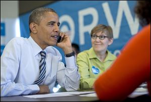 President Obama calls to thank volunteers in Wisconsin, at campaign office call center the morning of the 2012 election in Chicago. Carla Windhorst is seated next to the president.