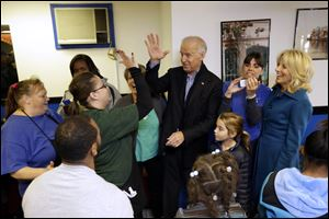 Vice President Joe Biden, accompanied by his wife Jill Biden, right, and granddaughter Natalie, meets with patrons during a visit to the Landmark Restaurant in Cleveland, Ohio.
