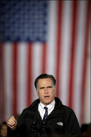Mitt Romney speaks to 10,000 cheering supporters at Port Columbus International Airport on Monday night.