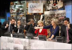 From left, ABC News' Chris Cuomo, actor Tony Danza, actor Andre Braugher, Barbara Walters, Cynthia McFadden and David Novarro manning phones to take donations for victims of Hurricane Sandy during 'Good Morning America' Monday.