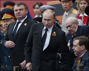 Russian President Vladimir Putin, left, has fired the country's defense minister Anatoly Serdyukov, right, two weeks after a criminal probe was opened into alleged fraud in the sell-off of military assets. Putin made the announcement of Serdyukov's dismissal today in a meeting with Moscow regional governor Sergei Shoigu, whom he appointed as the new minister.