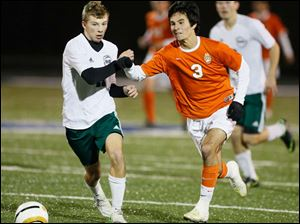 Southview's Jared Yoshino (3) battles Aurora's Joshua Hauman (11) for the ball.