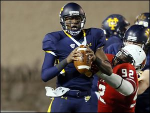 University of Toledo QB Terrance Owens (2) is sacked by  Ball State's Nathan Ollie (92) on the UT's last play.