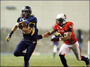 University of Toledo receiver Justin Olack (14) makes a catch against Ball State defender Jarrett Swaby (34).