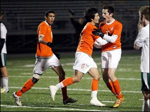 Southview's Jared Yoshino (3) celebrates scoring the game winning-goal with teammates Cody Shulak (6) and Omar Gad (9).