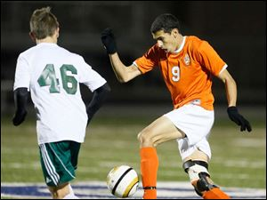 Sylvania Southview's Omar Gad (9) moves the ball.