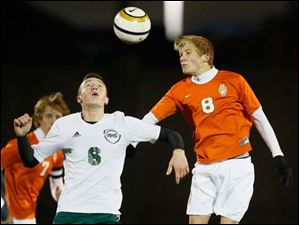 Southview's Jeff Letcher (8) moves the ball against  Aurora's Dalton Browsky (6).