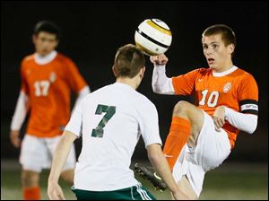 Sylvania Southview's Matt Turley (10) moves the ball against  Aurora's Kevin Blackley (7).