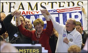 Congresswoman Marcy Kaptur celebrates her victory with supporters at the Teamsters Union Hall in Toledo. To her left is Bill Lichtenwald, president of Teamsters Local 20, and on her right is George Tucker, executive secretary of Greater NW Ohio AFLCIO.