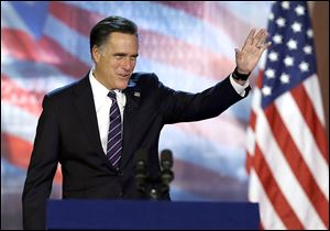 Republican presidential candidate and former Massachusetts Gov. Mitt Romney waves to supporters before conceding at his election night rally.