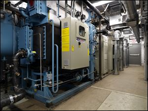 This modular co-generation unit is to produce continuous electricity to the university's data center. Plus, heat from the turbines will help keep the pool at the nearby rec center warm.