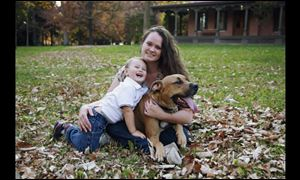 Carrisa Curry, shown with her son Kaleb Smart, 2, is appealing the Lucas County dog warden's designation of her dog Duke as dangerous.