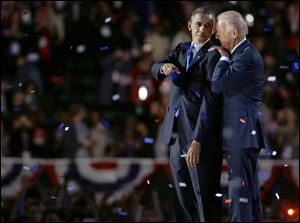 Vice President Joe Biden, right, talks to President Barack Obama after the president's victory speech Wednesday in Chicago.
