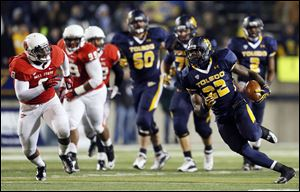 Toledo running back David Fluellen (22) rushed the ball 34 times for 200 yards. It was his third 200-yard game of the season.