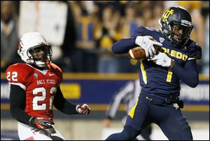 University of Toledo WR Bernard Reedy scores a touchdown early in the game Tuesday night at the Glass Bowl.