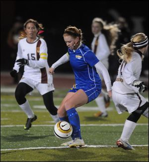 St. Ursula's Megan Rafac stops the ball against Walsh Jesuit during their game Tuesday.