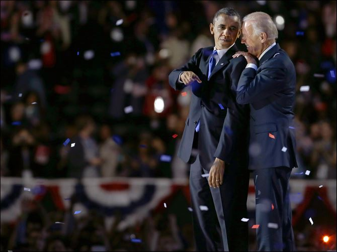 APTOPIX Obama 2012 Biden Vice President Joe Biden, right, talks to President Barack Obama after the president's victory speech Wednesday in Chicago.