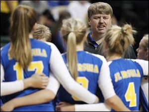 Toledo St. Ursula Academy head coach John Buck speaks to his players after the first set against Cincinnati Ursuline during their Division I semi-final match of the Ohio State Volleyball Championship at Wright State University's Nutter Center.