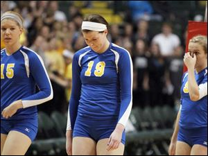 St. Ursula Academy players Elizabeth Coil, 15, Maddie Burnham, 19, and Emily Lydey, 9, walk off the court after losing to Cincinnati Ursuline.