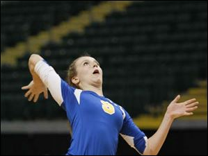 St. Ursula Academy player Emily Lydey, 9, serves the ball.